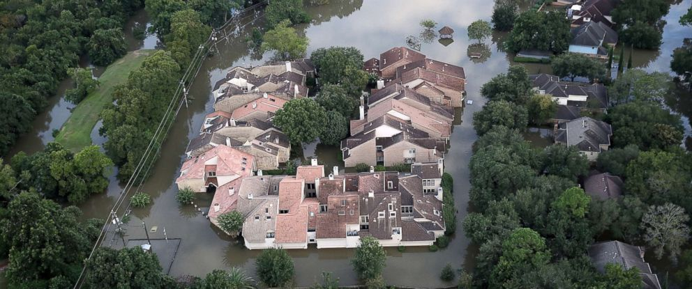 PHOTO: Flooding homes are shown near the Barker reservoir in Houston following Hurricane Harvey August 30, 2017 in Houston.