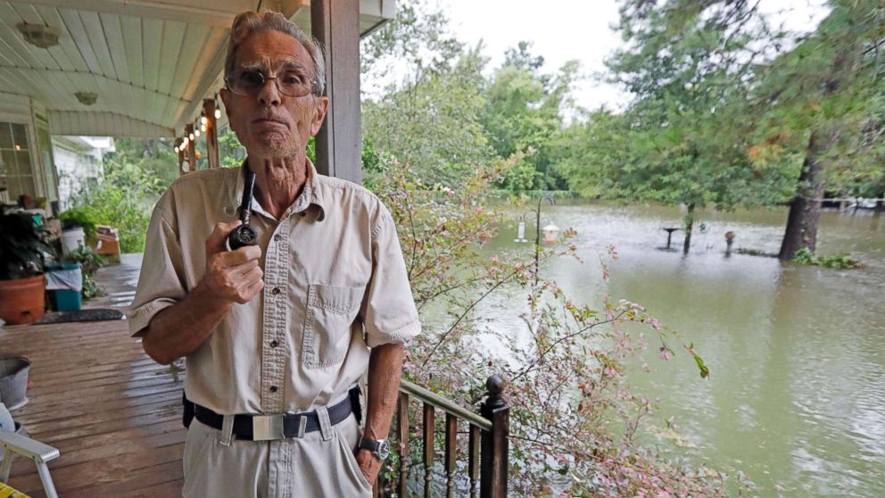 Jimmie Bradley speaks about the flooding in his neighborhood in Moss Bluff, a Lake Charles, La., suburb in Calcasieu Parish, Aug. 28, 2017. Bradley, 78, and his wife Brenda, had stacked sandbags at their doors, but the rising water was lapping at the steps to their back porch and had overtaken their front yard. Virtually every neighbor on Crawford Drive has at least a foot of water in their yards.