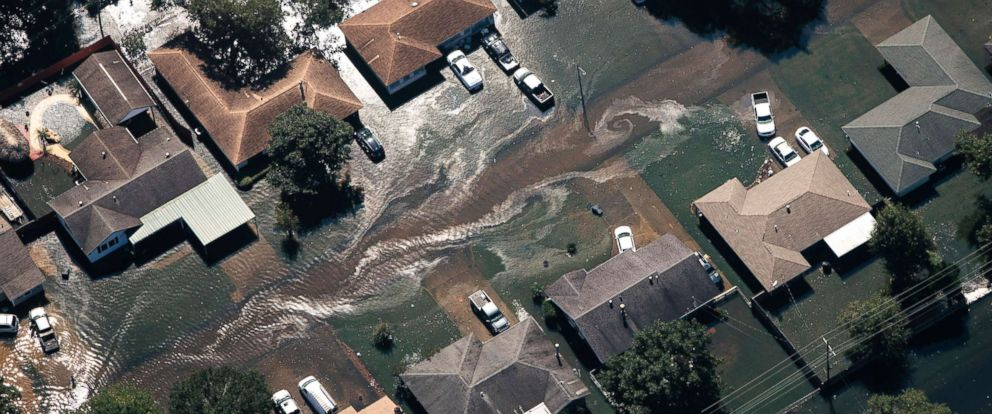 PHOTO: Polluted floodwater surrounds homes in Beaumont, Texas, about 70 miles east-northeast of Houston, Aug. 31, 2017.