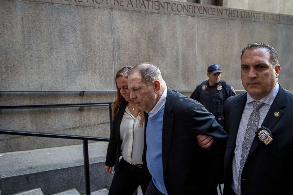 PHOTO: A handcuffed Harvey Weinstein is led into criminal court in lower Manhattan for arraignment on May 25, 2018.