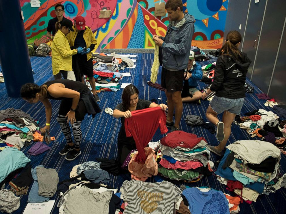 PHOTO: Volunteers sort through donated clothing at a shelter in the George R. Brown Convention Center during the aftermath of Hurricane Harvey, Aug. 28, 2017, in Houston.