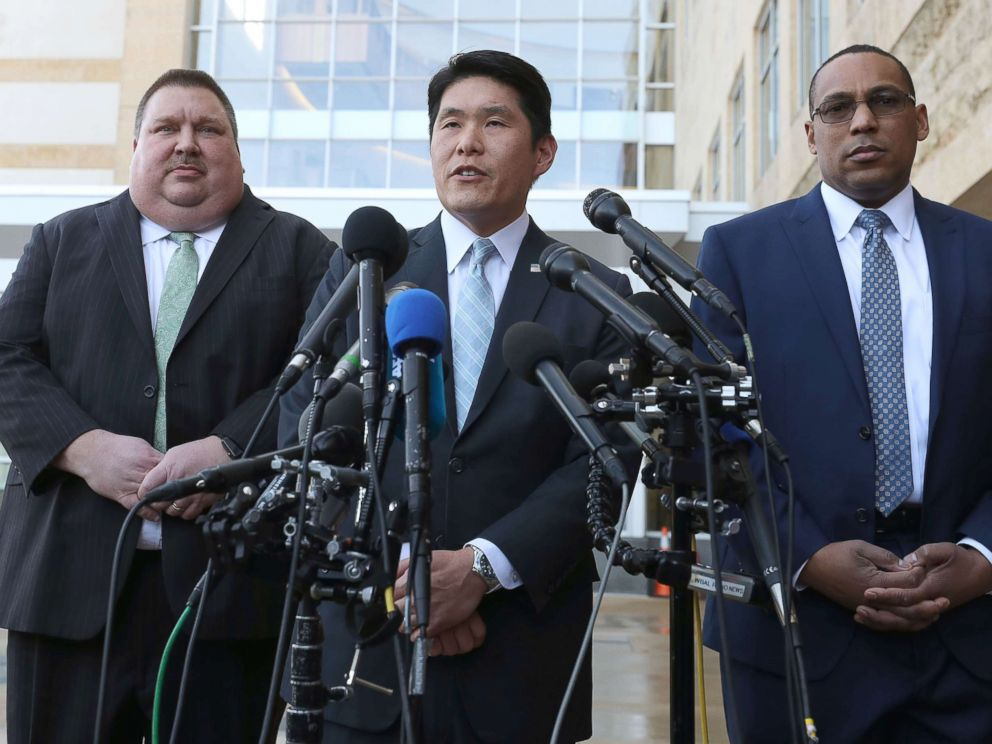PHOTO: U.S. Attorney Robert Hur, center, speaks while flanked by FBI Special Agent Gordon Johnson and Art Walker, of the Coast Guard Investigative Service, after a hearing at the U.S. District Court Greenbelt Division, Feb. 21, 2019, in Greenbelt, Md.