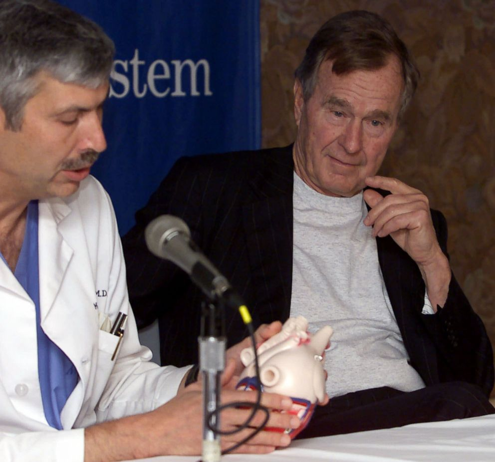 PHOTO: Former President George HW Bush, right, listens to cardiologist Mark Hausknecht talk about Bushs heart condition, during a news conference at Methodist Hospital, Feb. 25, 2000, in Houston.