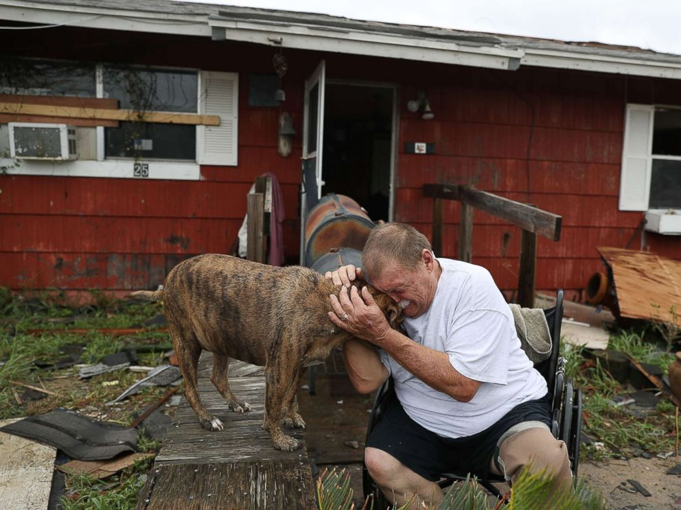 PHOTO: Steve Culver cries with his dog Otis as he talks about what he said was the, most terrifying event in his life, when Hurricane Harvey blew in and destroyed most of his home while he and his wife took shelter, Aug. 26, 2017, in Rockport, Texas.