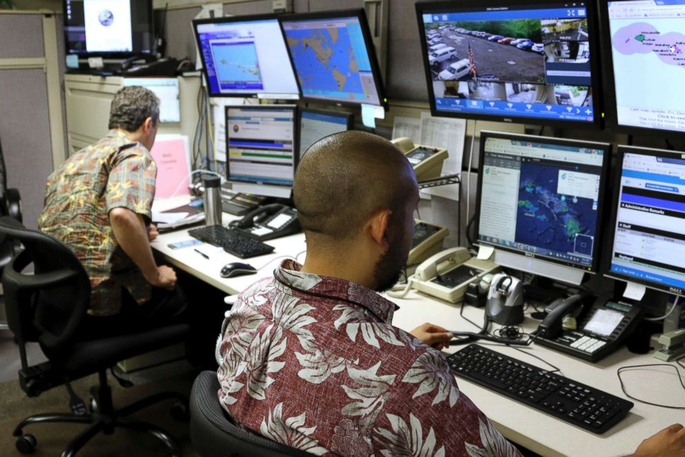 A December 2017 file photo showing the Hawaii Emergency Management Agency officials at work in the department's command center in Honolulu, Hawaii.