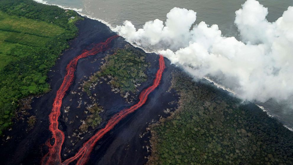 Steam plumes rise as lava enters the Pacific Ocean, after flowing to the water from a Kilauea volcano fissure, on Hawaii's Big Island, May 21, 2018, near Pahoa, Hawaii.