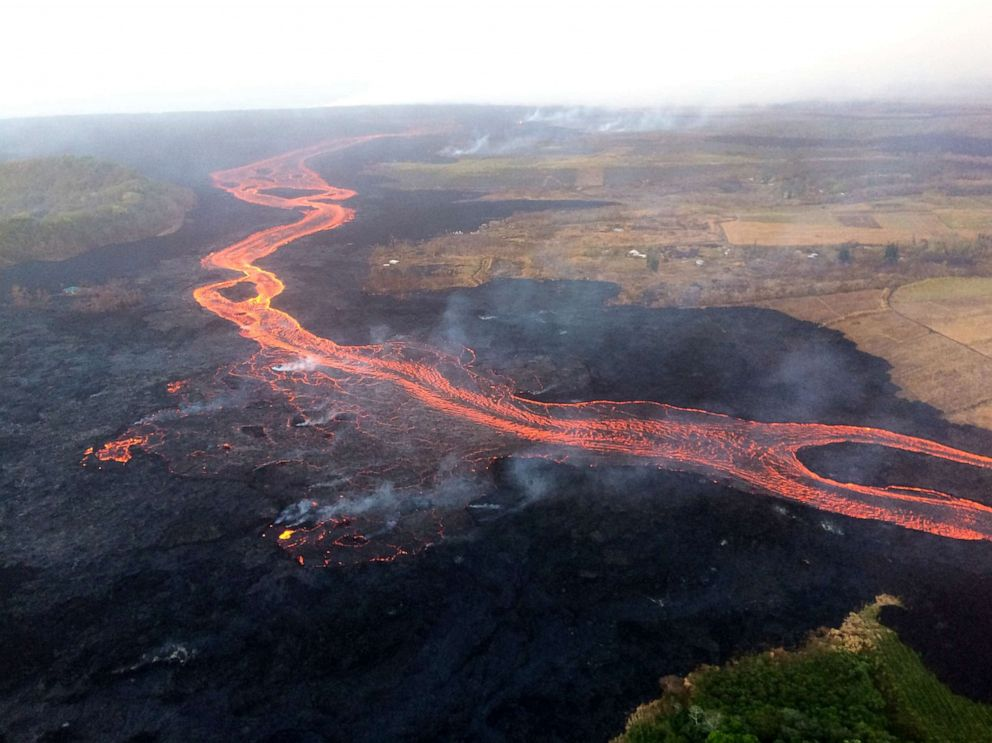 PHOTO: Lava from the Kilauea Volcano flows over Hawaiis Lower East Rift Zone, July 2018.