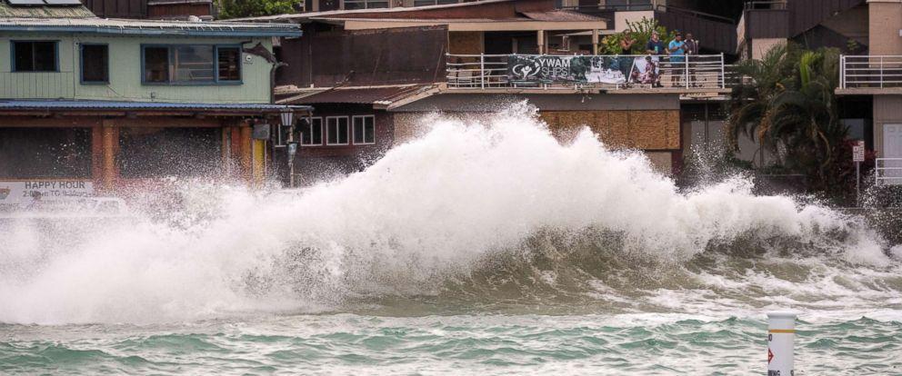 PHOTO: Visitors watch the rising surf generated by Hurricane Lane crash upon the Kailua Kona coastline, Hawaii, Aug. 23, 2018.