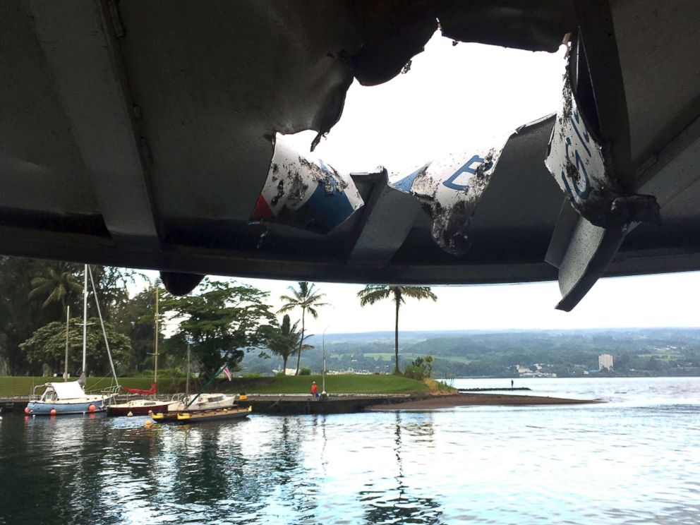 PHOTO: This photo provided by the Hawaii Department of Land and Natural Resources shows damage to the roof of a tour boat after an explosion sent lava flying through the roof off the Big Island of Hawaii on July 16, 2018, injuring at least 23 people.