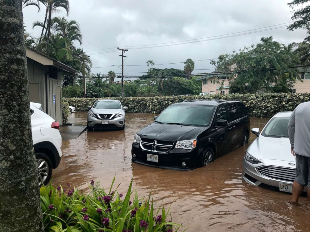Lauren Greer  APWater floods a parking lot at a condo complex near Kahana Village in Lahaina Hawaii Sept. 12 2018