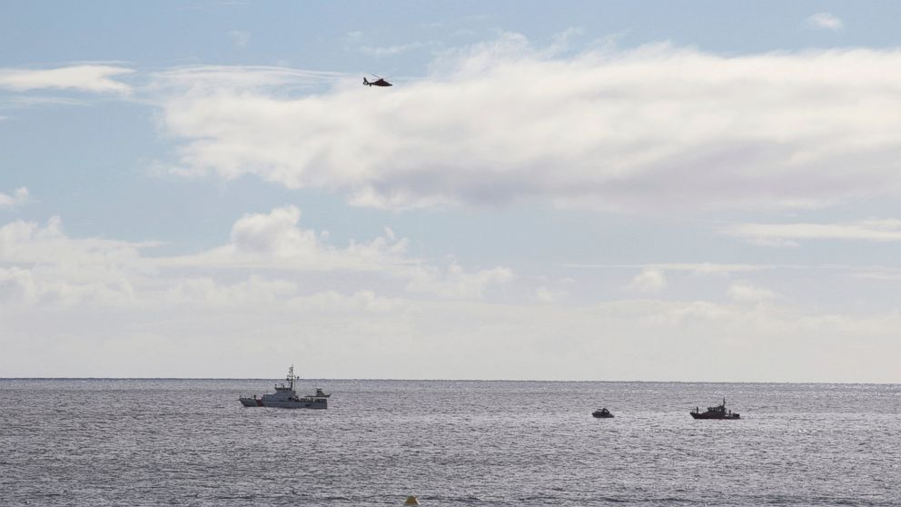 A U.S. Coast Guard vessel and other rescue boats respond to a plane crash off Honolulu, Wednesday, Dec. 12, 2018. Federal Aviation Administration spokesman Ian Gregor said a Hawker Hunter jet went down in the ocean around 2:25 p.m.