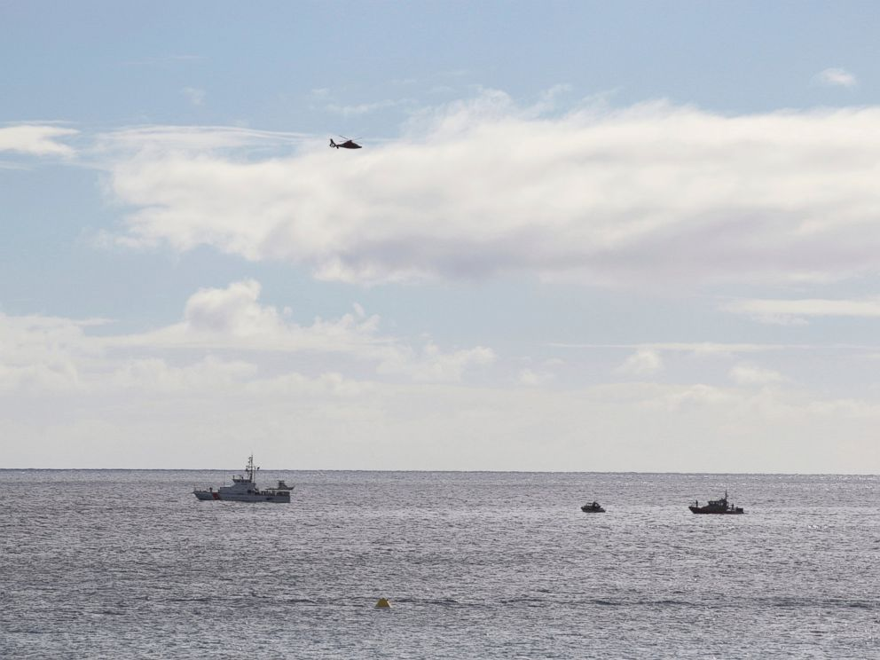 PHOTO: A U.S. Coast Guard vessel and other rescue boats respond to a plane crash off Honolulu, Wednesday, Dec. 12, 2018. Federal Aviation Administration spokesman Ian Gregor said a Hawker Hunter jet went down in the ocean around 2:25 p.m.