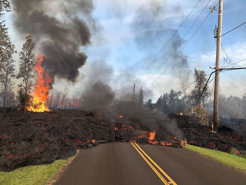 PHOTO: Lava from a fissure slowly advances to the northeast on Hookapu Street in Leilani Estates, Hawaii, May 5, 2018.