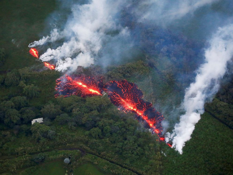PHOTO: Lava erupts from a rift east of the Leilani site during volcanic eruptions of the Kilauea volcano in Hawaii on May 13, 2018.
