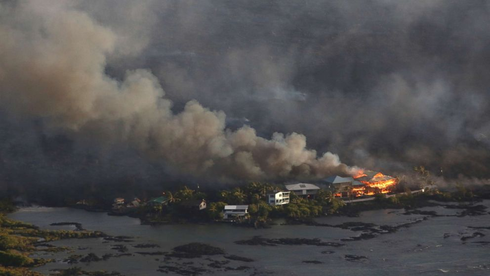 Lava destroys homes in the Kapoho area, east of Pahoa, during ongoing eruptions of the Kilauea Volcano in Hawaii, June 5, 2018.