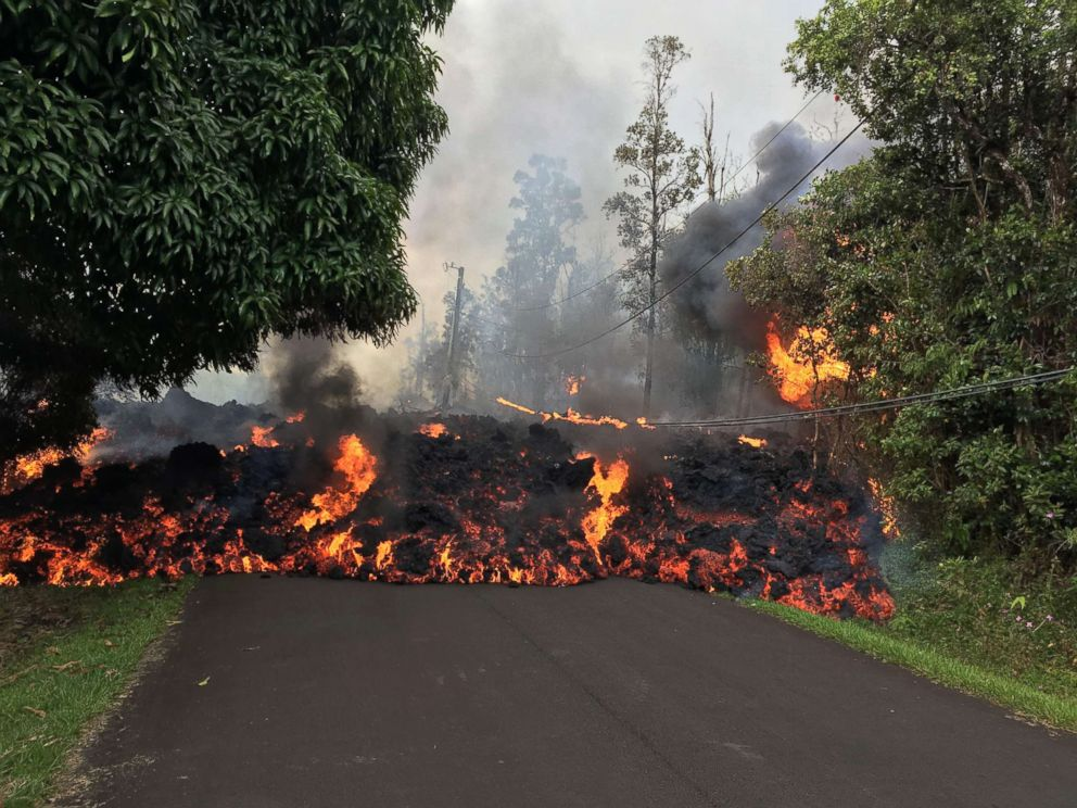 PHOTO: This image obtained May 9, 2018, released by the US Geological Survey shows a lava flow moving on Makamae Street in Leilani Estates at 09:32 am local time, on May 6, 2018 in Leilani Estates, Hawaii.