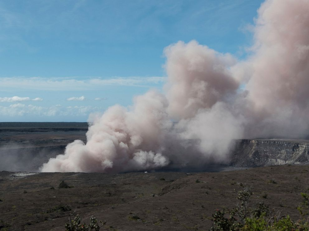 This Friday, May 11, 2018, published by the US Geological Survey, an ash cloud rises from the Overlook Vent in the Halemaumau Crater of Kilauea Volcano on the Big Island of Hawaii