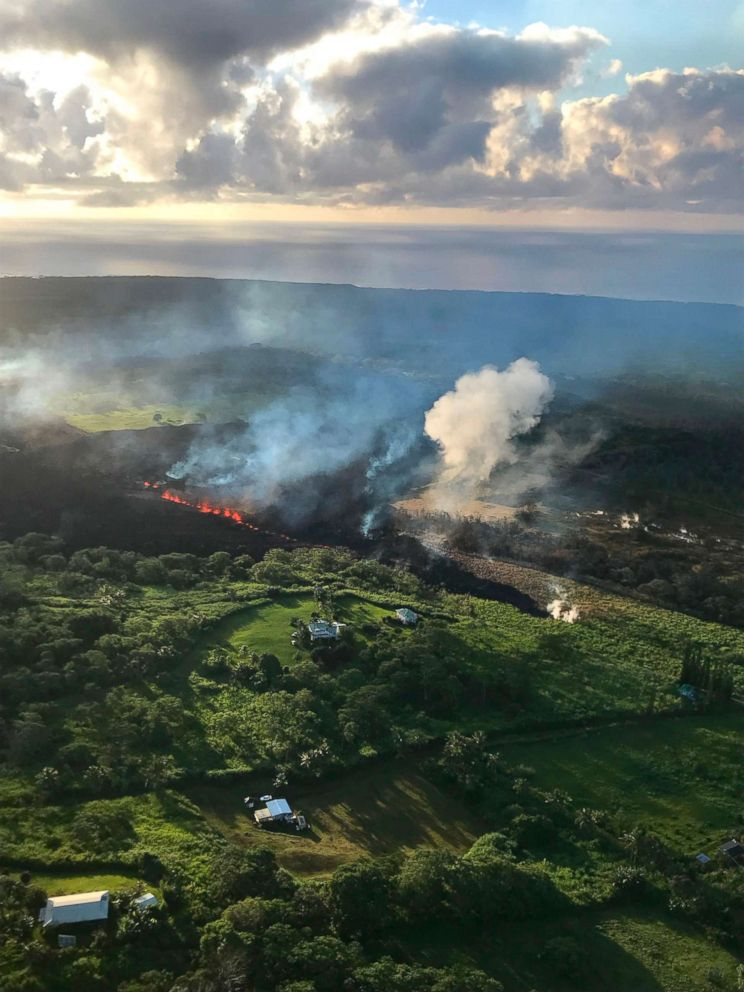 PHOTO: This image released by the US Geological Survey shows a fissure still erupting on May 14, 2018, and supplying lava to a flow that was still advancing at Hawaiis Big Island.
