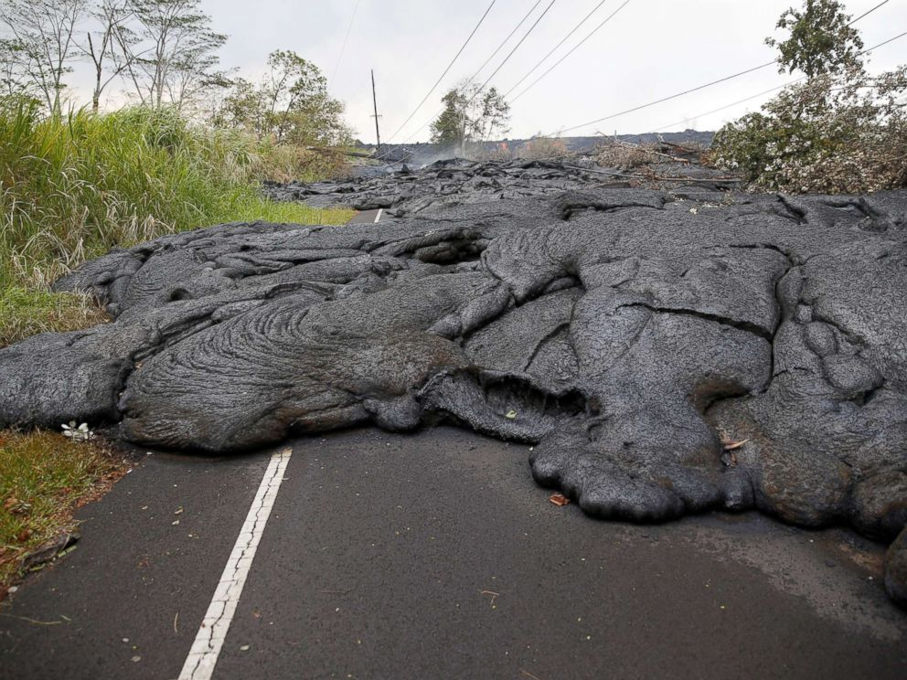 PHOTO: Lava covers Pohoiki Road near Pahoa, Hawaii, May 29, 2018.