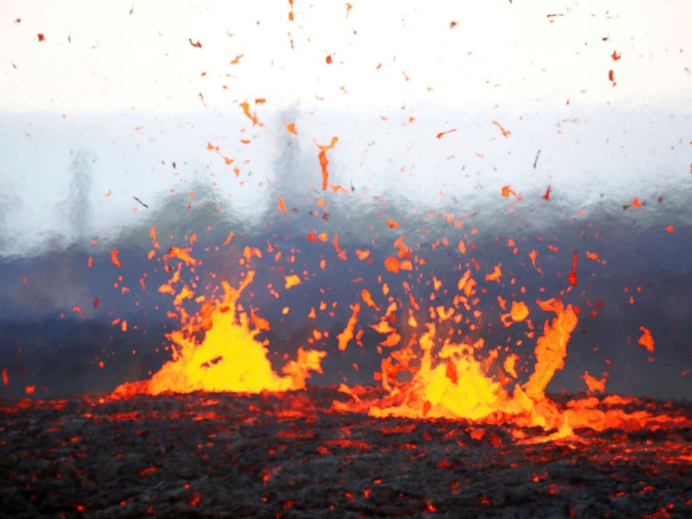 PHOTO: Lava erupts from a fissure on the outskirts of Pahoa during ongoing eruptions of the Kilauea Volcano in Hawaii, May 14, 2018.