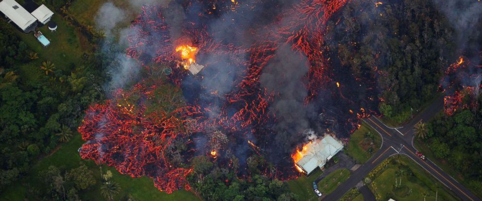 PHOTO: Molten flows into the Leilani Estate subdivision, near Pahoa, Hawaii, May 6, 2018. A local state of emergency was declared after Mount Kilauea erupted near residential areas, forcing mandatory evacuations.