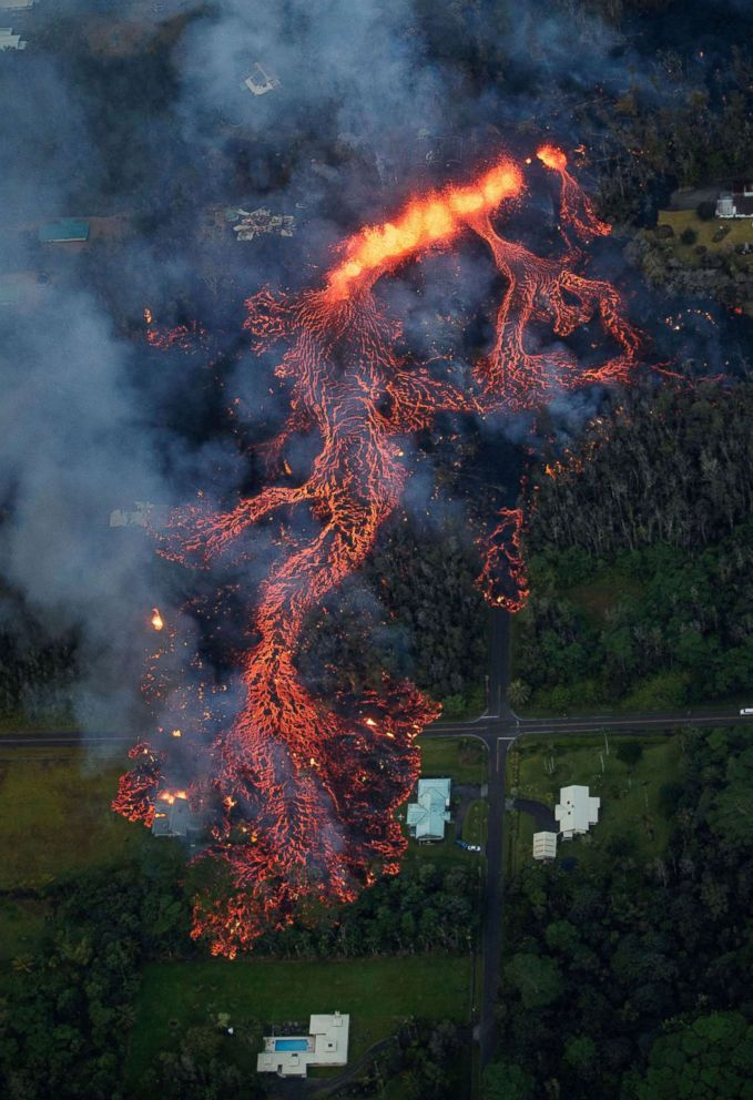 PHOTO: Volcanic lava flows down Kilaueas east rift zone, as a robust fissure eruption in Leilani Estates sends a massive flow into the subdivision, near Pahoa, Hawaii, May 6, 2018.