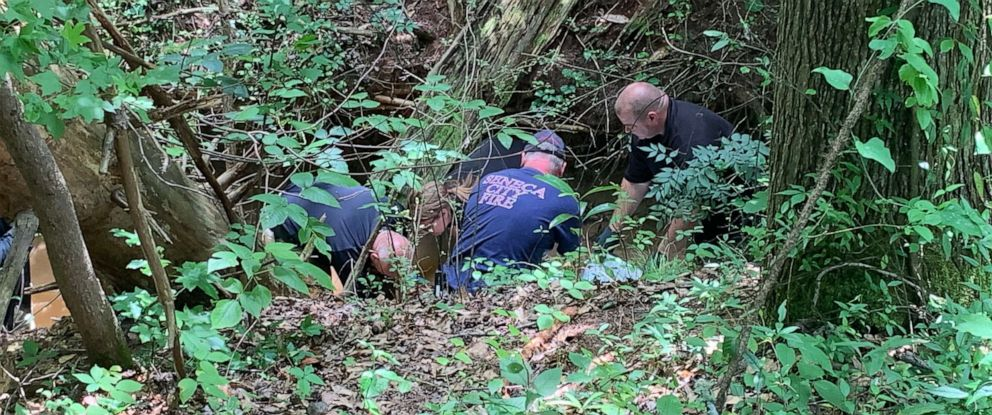 PHOTO: Authorities investigate a scene where officials say a head and torso were found near a creek in Seneca, S.C., on June 24, 2019.