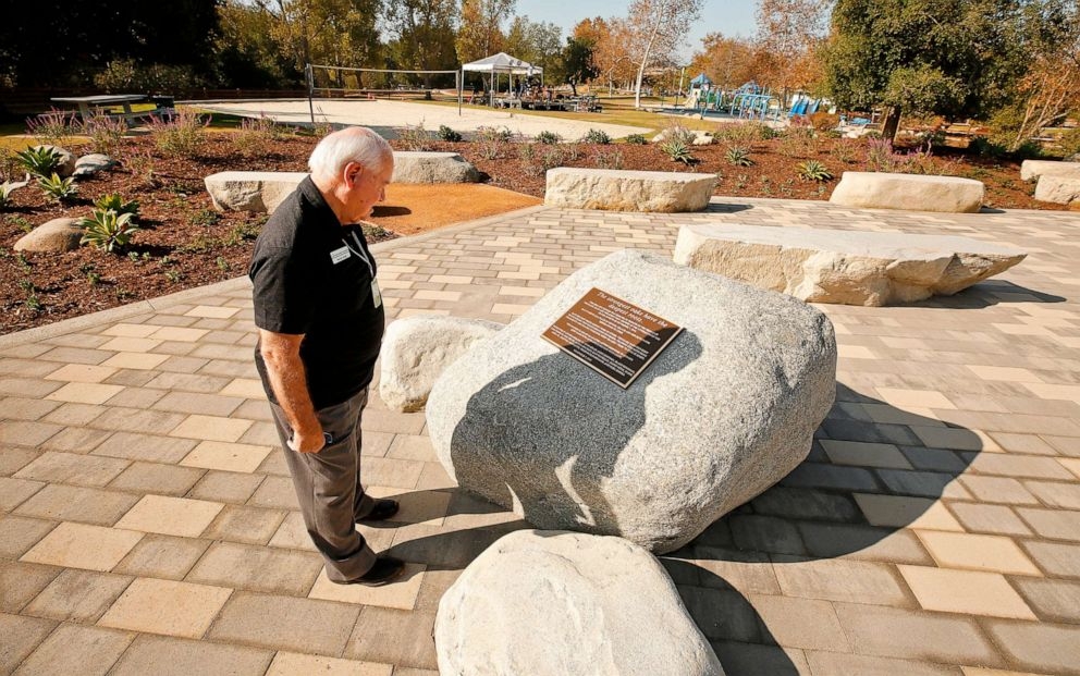 PHOTO: George Lange, Vice Chairman of the Board of Directors for the Conejo Recreation & Park District looks at the memorial plaque before dedication services at the Healing Garden constructed in Thousand Oaks, Calif., Nov. 7, 2019.