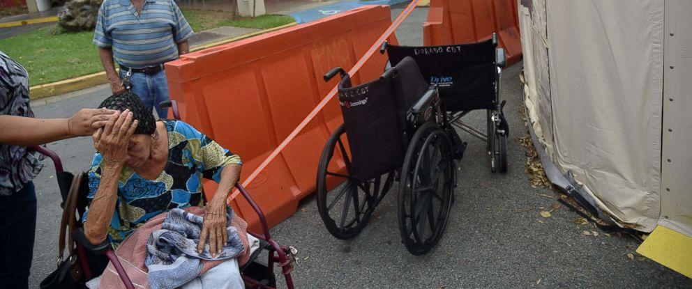 PHOTO: Angelina Rodriguez Lopez (L) waits for medical attention at Dorado Medical Center, in Dorado, Puerto Rico, Sept. 30, 2017.