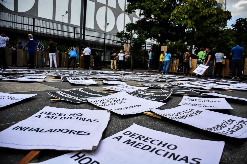 PHOTO: Signs lie on the ground as demonstrators take to the streets of Caracas, Venezuela on Nov. 30, 2017 to protest against the countrys lack of medicine and general health crisis.