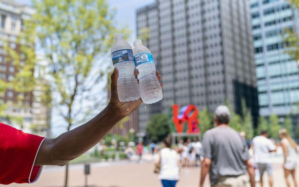 PHOTO: A man sells bottles of water in sweltering heat on July 1, 2018 in Philadelphia.