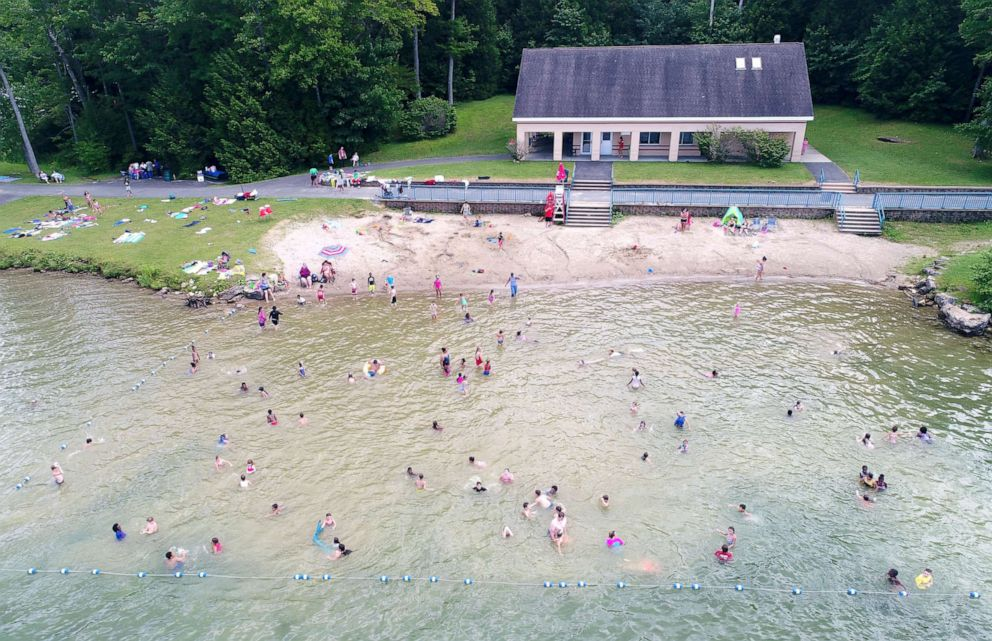 PHOTO: Swimmers cool off at the beach at Burbank Park on Onota Lake in Pittsfield, Mass., July 19, 2019.