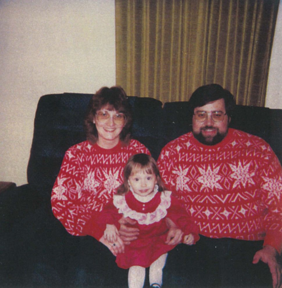 PHOTO: Heather with her adoptive parents Don and Frieda Robinson.