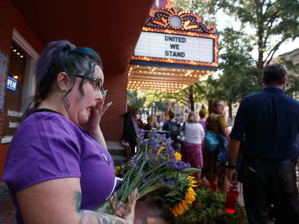PHOTO: Cynthia Sullivan of Charlottesville, Va., stands in line for a memorial service for Heather Heyer, who was killed during a white nationalist rally, Aug. 16, 2017, in Charlottesville, Va.