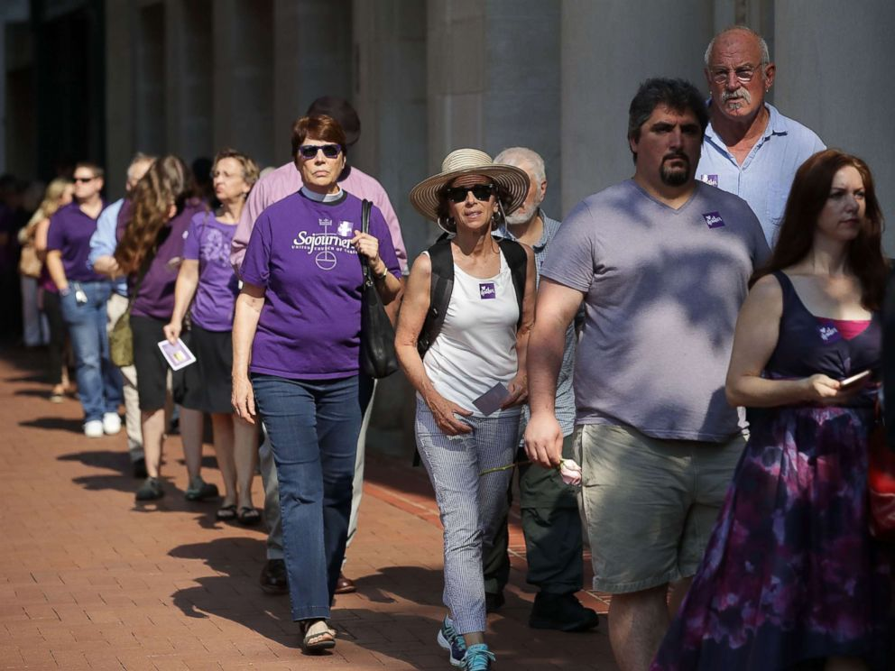 PHOTO: People line up to attend the memorial service for Heather Heyer, who was killed when a car slammed into a crowd of people protesting against a white supremacist rally, Aug. 16, 2017, in Charlottesville, Va.