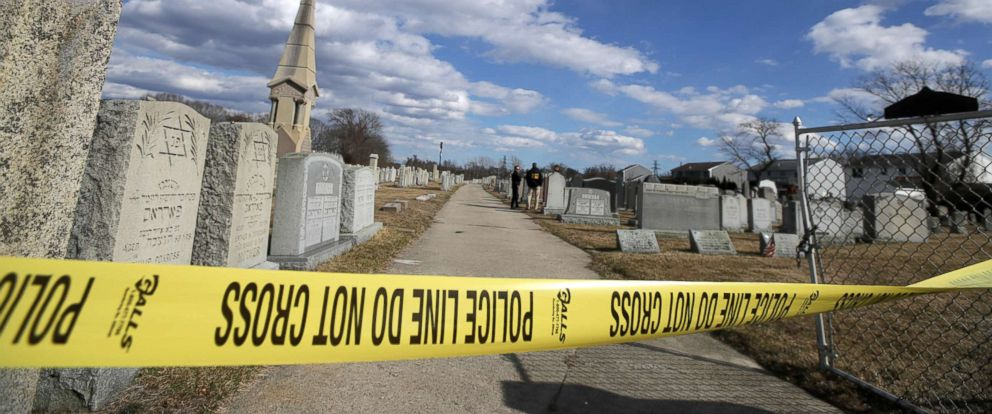 PHOTO: Police tape hangs in front of gravestones at the Hebrew Cemetery in Fall River, Mass., where markers were vandalized, March 19, 2019.