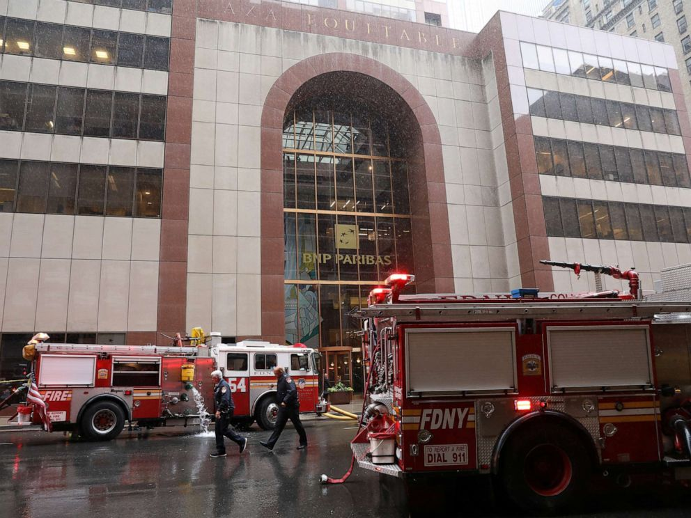 PHOTO: New York City Fire Department trucks are seen outside 787 7th Avenue in midtown where a helicopter was reported to have crashed in New York, June 10, 2019.