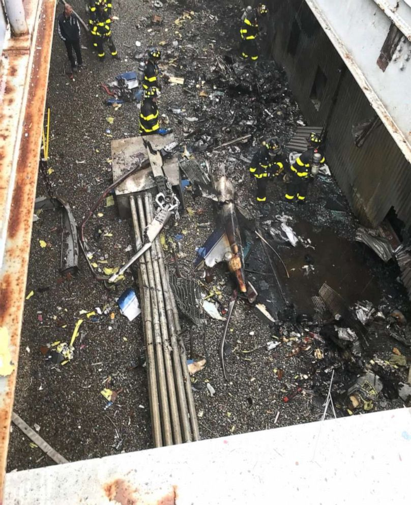 PHOTO: Firefighters at the scene of a helicopter crash at 787 7th Ave. in New York, June 10, 2019.
