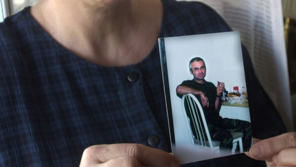 Lucyna Siwiak holds a photo of her brother Henryk Siwiak, at home in New York, Jan. 18, 2002.