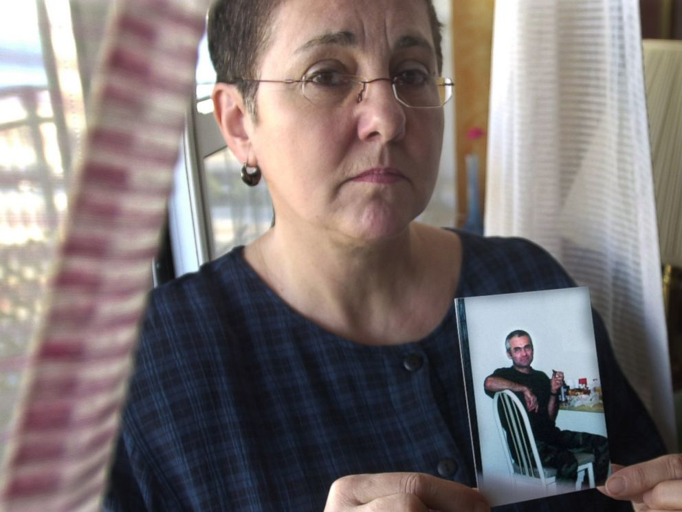PHOTO: Lucyna Siwiak holds a photo of her brother Henryk Siwiak, at home in New York, Jan. 18, 2002.