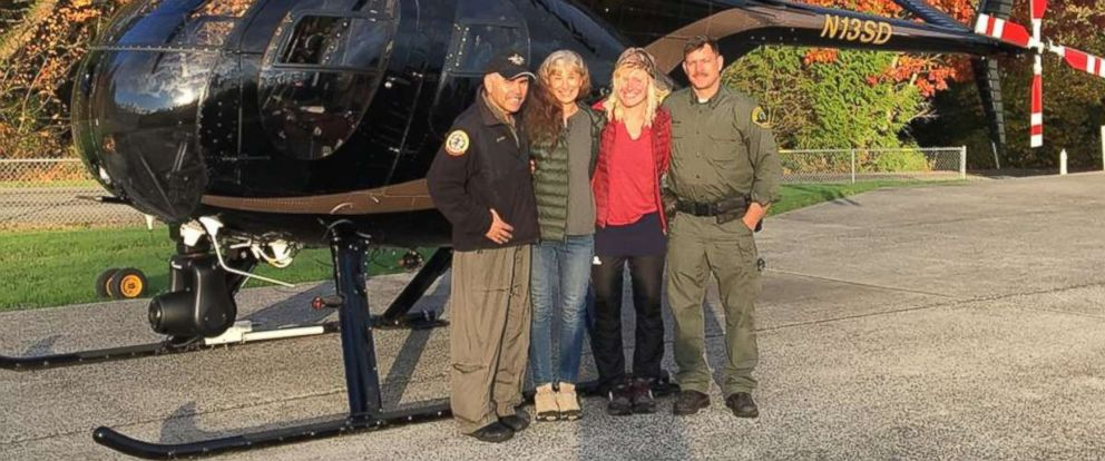 Chief pilot Bill Quistorf, Nancy Abell, Katharina Groene and pilot Einar Espeland pose for a photo after the Snohomish County Sheriffs Office search and rescue team found Groene lost on the Pacific Coast Trail after a call from Abell on Oct. 29, 2018.