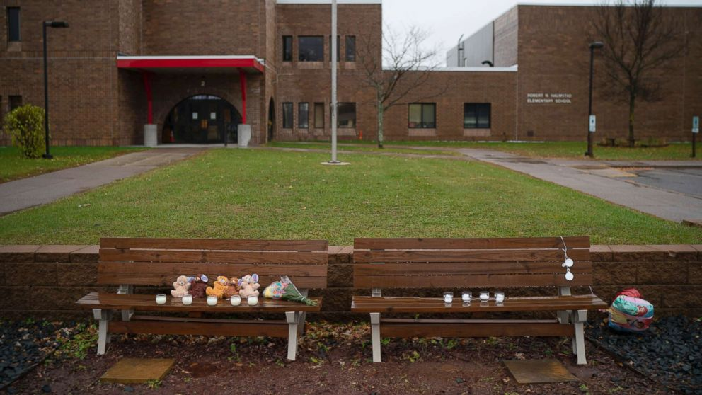 Teddy bears, flowers, and candles were placed on benches outside Halmstad Elementary School in Chippewa Falls, Wis. as a memorial to the three Girl Scouts who were struck and killed by a driver who fled the scene, Nov. 4, 2018.