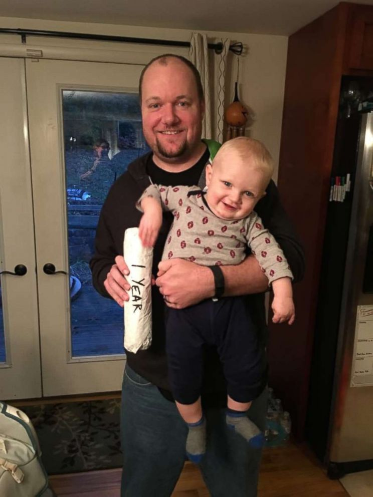 Brad Williams with his son, and a cheesesteak, at 1 year old.
