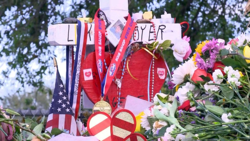 The Marjory Stoneman Douglas High School Eagles hockey team state championship medals are seen decorating memorials dedicated to victims of the mass shooting in Parkland, Fla., Feb. 26, 2018.