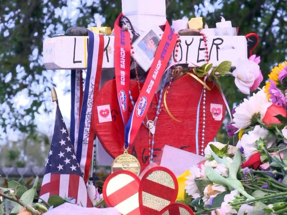 PHOTO: The Marjory Stoneman Douglas High School Eagles hockey team state championship medals are seen decorating memorials dedicated to victims of the mass shooting in Parkland, Fla., Feb. 26, 2018.