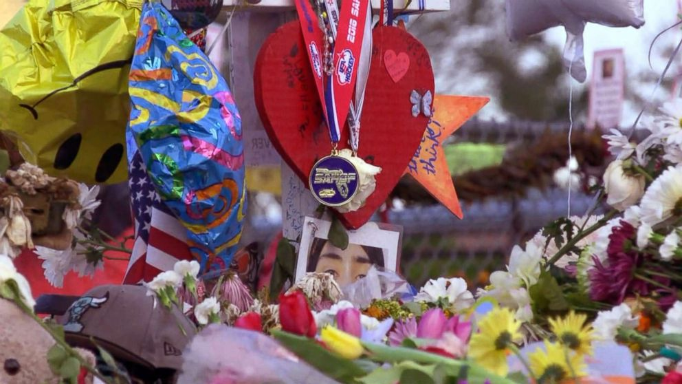 The Marjory Stoneman Douglas High School Eagles hockey team state championship medals are seen decorating memorials dedicated to victims of the mass shooting in Parkland, Fla., Feb. 26, 2018..