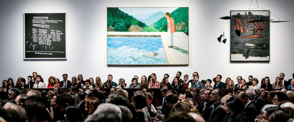 """PHOTO: The painting """"Portrait of an Artist (Pool with Two Figures)"""" by artist David Hockney, center, is displayed during the sales event of the Post War and Contemporary Art Evening Sale at Christies auction house in New York City, Nov. 15, 2018."""