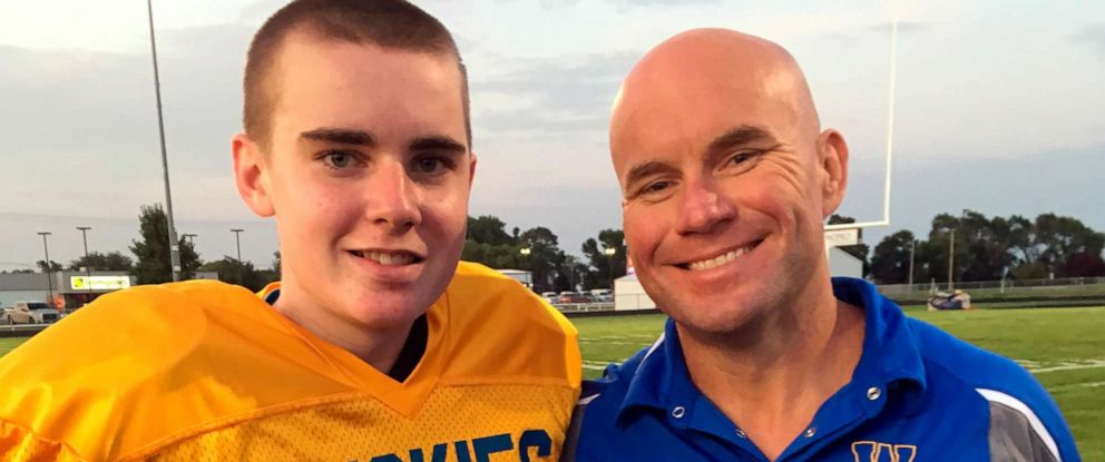 PHOTO: In this photo taken Monday, Sept. 16, 2019 and provided by the Hoffman family, Jack Hoffman and his father Andrew Hoffman poses before a football game in Atkinson, Neb.