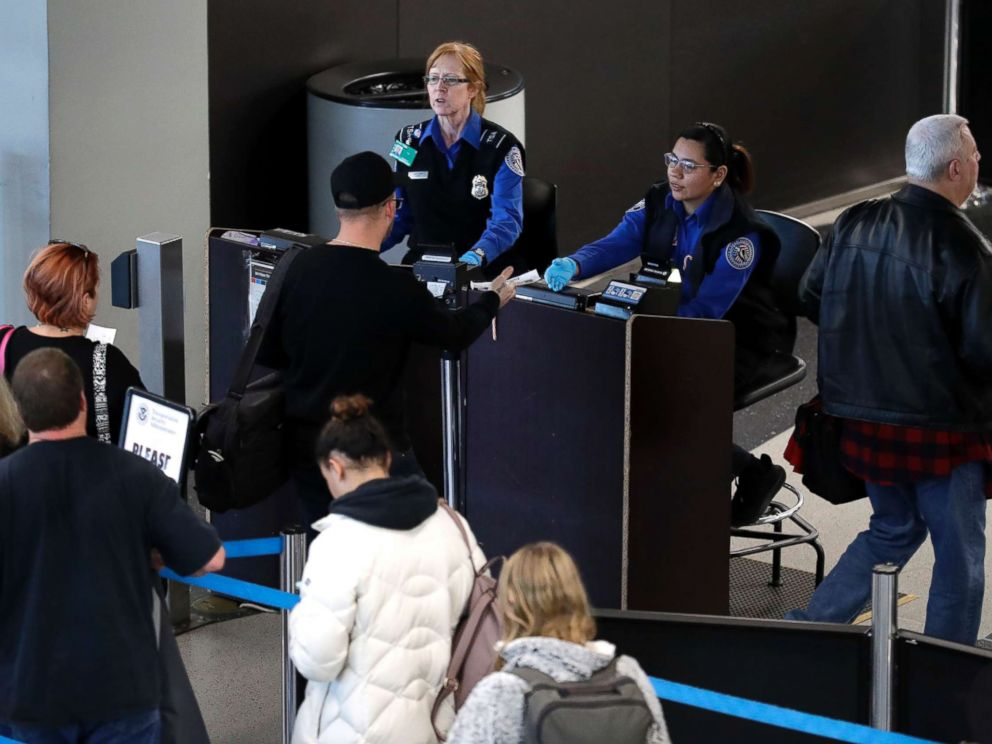 PHOTO: Transportation Security Administration workers screen passengers at OHare International Airport, Tuesday, Dec. 25, 2018, in Chicago.
