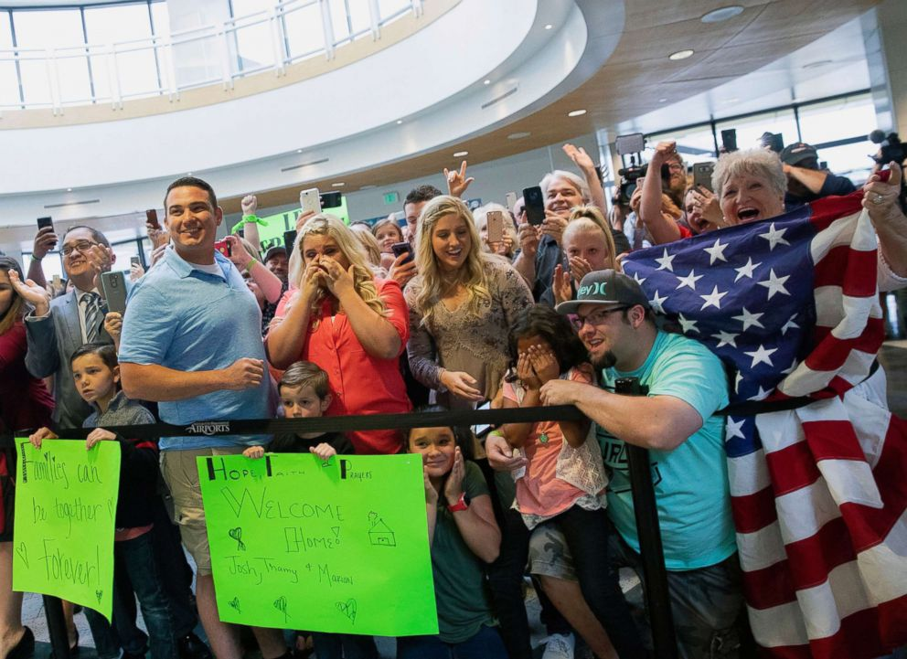 Kim Raff  APFriends and family react as Josh Holt and his family arrive in Salt Lake City